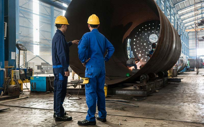 Two workers in Manfacturing Plant - SIPMM